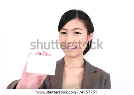 Business woman showing blank card. Focus on face. isolated over white - stock photo
