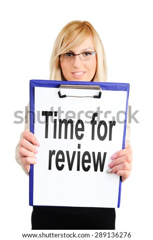 Business woman showing clipboard with time for review - stock photo