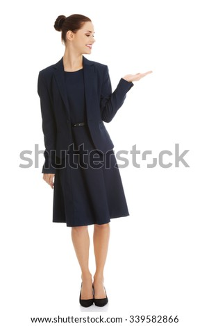 Business woman showing something or copyspase for product or sign text - stock photo