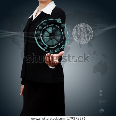 Business woman  showing the globe and icon application on virtual screen. Concept of online business. - stock photo