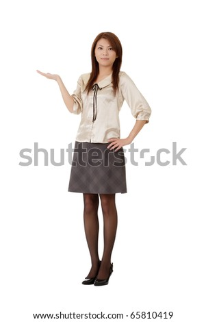 Business woman showing with hand on white space isolated over white. - stock photo