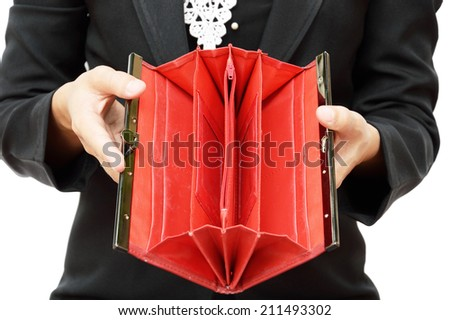 business woman shows her empty wallet isolated on white - stock photo