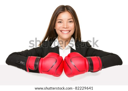 business woman sign - boxing gloves. Businesswoman boxer in suit showing blank empty paper poster billboard sign smiling happy. Beautiful Asian / Caucasian young female professional isolated on white - stock photo