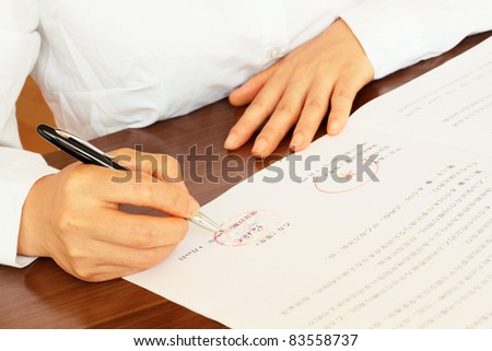 Business woman signing a contract in Mandarin, Chinese