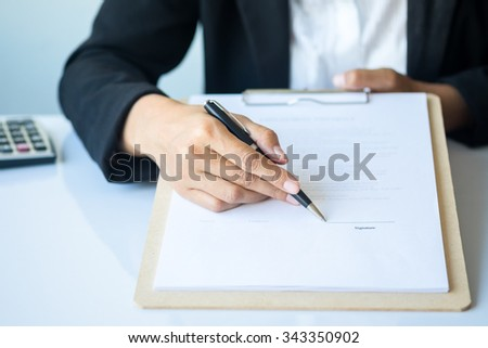 Business woman signing a contract(selective focus)