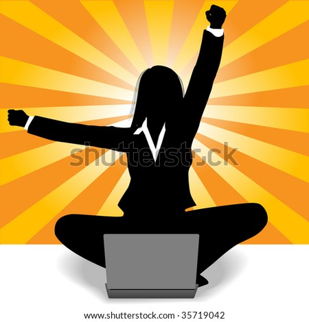 Business woman sits at laptop computer and raises fist and arm to celebrate her success. - stock photo