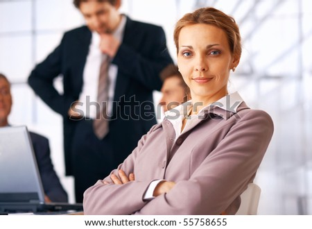 Business woman sitting at the business meeting with her colleagues at the background. - stock photo