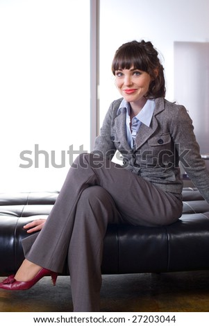 Business woman sitting in a modern office