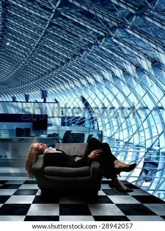 business woman sleeping on an airport armchair - stock photo