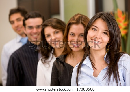 business woman smiling leading a team in an office
