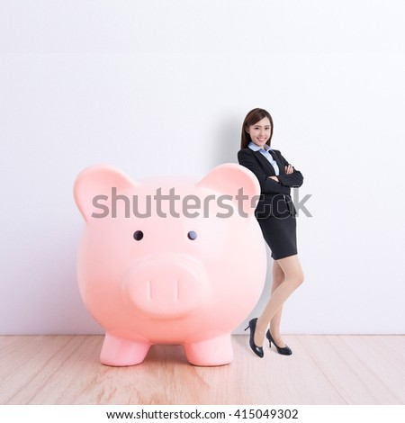 business woman stand with pink piggy bank with white wall background, great for your design or text, asian