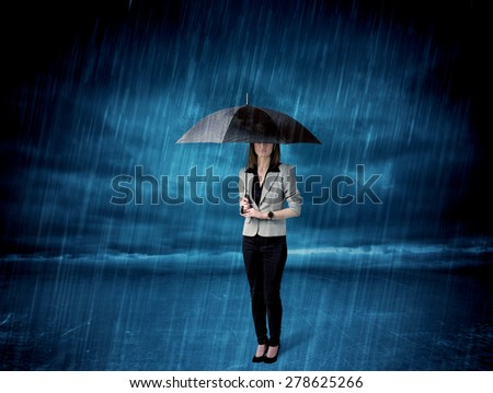 Business woman standing in rain with an umbrella concept on background - stock photo