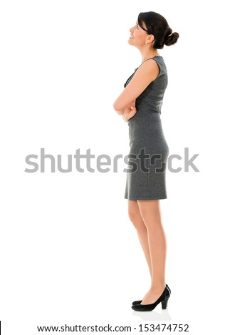Business woman standing looking up - isolated over a white background