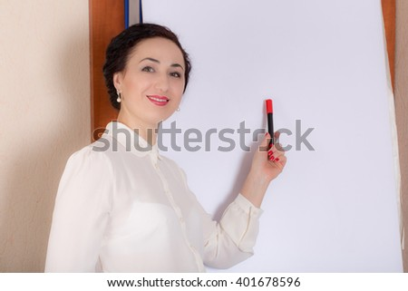 Business woman standing near the whiteboard with a marker. Photo can be used as a whole background. - stock photo