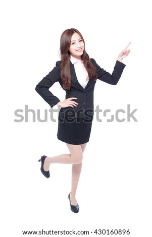 business woman stands in full length,pointing something, Asia beauty - stock photo