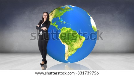 Business woman stands near big earth ball in the gray room. Elements of this image furnished by NASA - stock photo