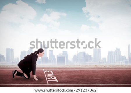 Business woman start to run. Business career start concept - stock photo