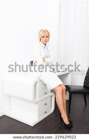 Business woman stomach ache, sick  businesswoman hold hand on stomach pain, young girl sitting at modern office desk - stock photo