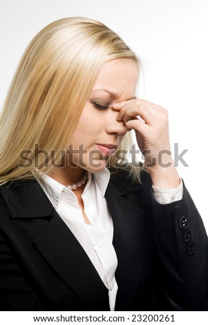 Business woman suffers from a headache on a white background - stock photo