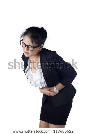 Business woman suffers from stomachache, isolated on white background, Model is Asian woman. - stock photo