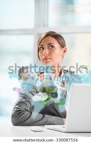 Business woman surfing on web with modern laptop - stock photo