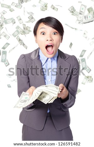 business woman surprised facial expression with falling money isolated on white background, asian model - stock photo