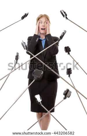 business woman surrounded by selfie stick not looking very happy - stock photo