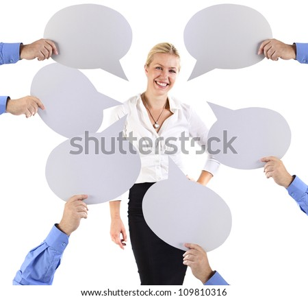 Business woman surrounded by speech bubbles - stock photo