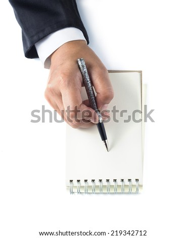 Business woman takes notes on white background - stock photo