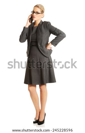 Business woman talking on her mobile phone. - stock photo