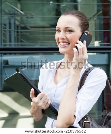 Business woman talking on her mobile smart phone. - stock photo