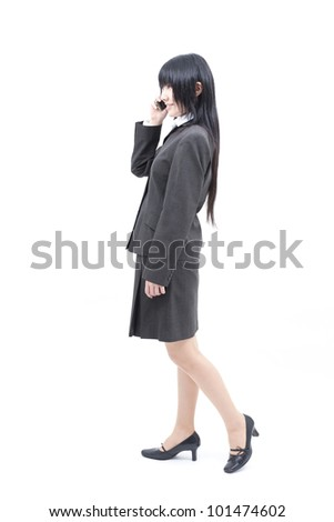 Business woman talking on mobile phone isolated on white background - stock photo