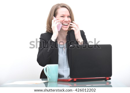 Business woman talking on phone and laughing while getting good news - stock photo