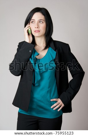 Business woman talking on the cell phone with worried expression. - stock photo