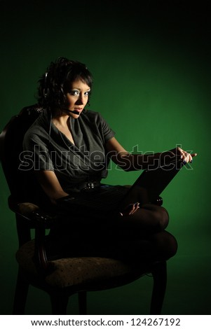 Business woman talking on the internet with headphones
