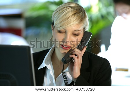 Business woman talking on the phone in the office - stock photo