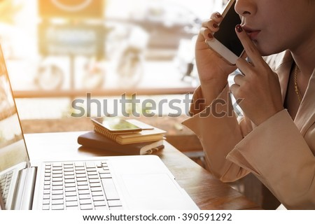 Business woman talking Secrets on the phone at morning light.Vintage effect - stock photo
