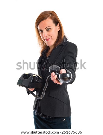 Business woman talking to vintage phone