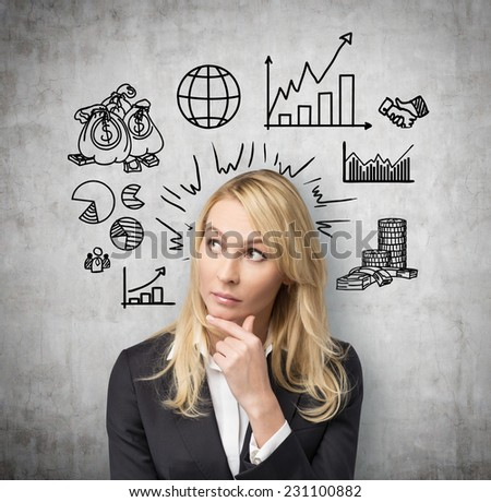 Business woman thinking about wall's flow chart and trying to imply it into a new start up project. - stock photo
