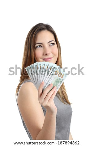 Business woman thinking and holding money isolated on a white background - stock photo