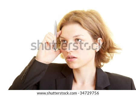 Business woman thinking with pen in her hand - stock photo