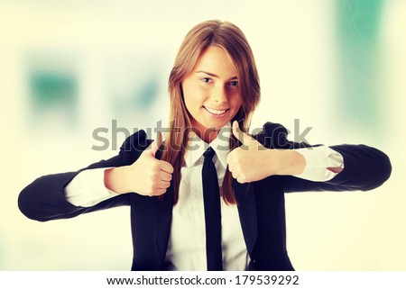 Business woman thumbs up  - stock photo
