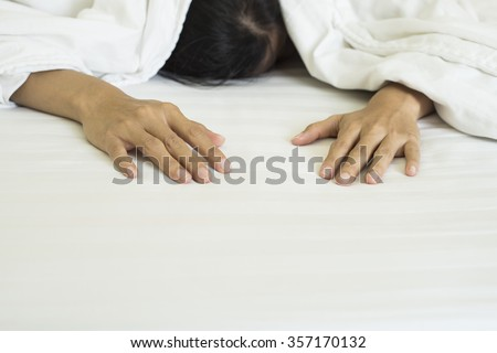 business woman tired and sleeping in an hotel bed - stock photo