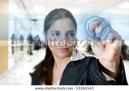 Business woman touch digital interface with a pen (Business and technology concept) - stock photo