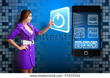 Business woman touch Power icon from mobile phone - stock photo