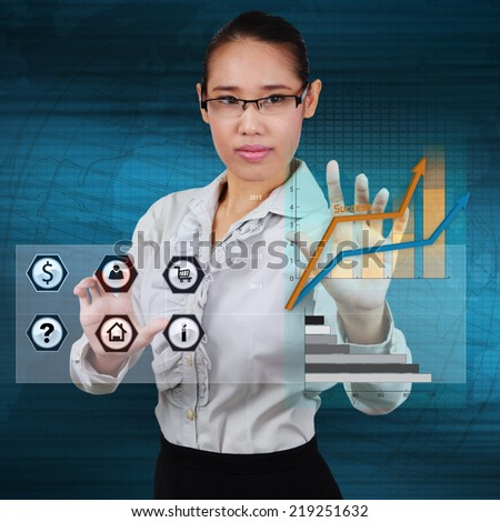 Business woman touching a icon application and graph on virtual screen. Concept of online business. - stock photo