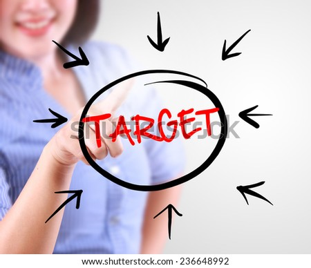 Business woman touching business target - stock photo