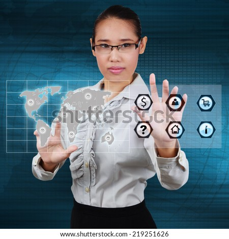 Business woman touching the globe and icon application on virtual screen. Concept of online business.
