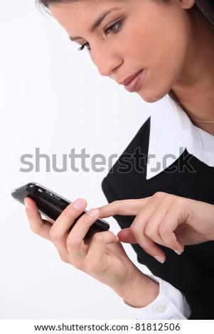 business woman typing on mobile telephone - stock photo