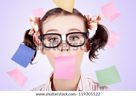 Business Woman Under Stress With Face Covered In Paper Reminder Notes Of Unfinished Tasks